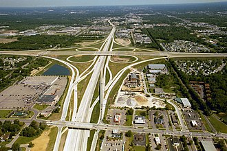 Controlled-access highway - The interchange between US-131, M-6 and 68th Street in Wyoming, Michigan, shows many of the features of controlled-access highways—opposing traffic on separate carriageways, no at-grade intersections and no direct access to properties.