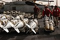 US Navy 030321-N-6817C-096 Aviation Ordnancemen, assigned to Weapon's Department, move ordnance across the flight deck prior to loading it onto aircraft aboard USS Abraham Lincoln (CVN 72).jpg