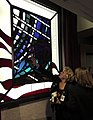 US Navy 030911-N-9593R-013 Guests at the dedication ceremony on Sept. 11, 2003 for stained glass windows built for the new Pentagon Chapel, touch pieces of the glass that they and their friends put into the art work.jpg