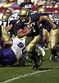 US Navy 031004-N-6157F-012 Navy senior quarterback Craig Candeto looks for a hole in the Air Force defensive line.jpg