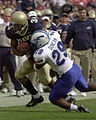US Navy 031004-N-9693M-482 Navy slotback Eric Roberts is tackled by Air Force defender Larry Duncan.jpg