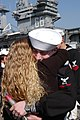 US Navy 031105-N-1356A-004 Damage Controlman 3rd Class Thomas Howard embraces his wife.jpg