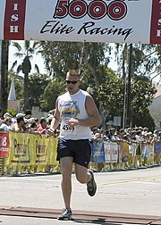 US Navy 040328-N-8977L-003 U.S. Marine Corps 1st Lt. David Cote, of Marine Medium Helicopter Training Squadron One Six Four (HMM-164), finishes the Carlsbad 5000 road race at about 25 minutes.jpg