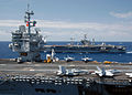 US Navy 040423-N-8704K-011 USS Enterprise (CVN 65) and USS John F. Kennedy (CV 67) steam along side each other while transferring ammunition in the Atlantic Ocean.jpg