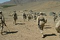 US Navy 040602-M-8096M-018 U.S. Marines assigned to Battalion Landing Team 1st Bn., 6th Marines wait for the word to move toward a mountain.jpg