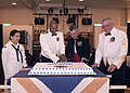 US Navy 041009-N-7512V-047 Commander Fleet Activities Okinawa, Capt. Robert D. Wilson, center left, and guest speaker, Commanding General, Marine Corps Bases, Japan, Lt. Gen. R. Blackman Jr., center right, cut the cake during t.jpg
