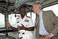 US Navy 041015-N-7293M-086 Commander, U.S. Naval Forces Marianas, Rear Adm. Arthur Johnson, and Secretary of the Navy (SECNAV), the Honorable Gordon R. England, talk on the bridge of the new Coast Guard cutter Sequoia (WLB 215).jpg
