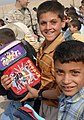 US Navy 041026-M-1250B-009 Iraqi children receive school supplies from U.S. Marines and Sailors assigned to the 24th Marine Expeditionary Unit (MEU) during a Back-to-School campaign.jpg