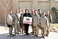 US Navy 041202-M-8479B-016 California State Senator Dianne Feinstein, take a group photo with Sailors and Marines from California at Camp Fallujah, Iraq.jpg