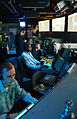 US Navy 050519-N-6410T-002 Air Traffic Controller 2nd Class Robert Mutter, standing, trains Air Traffic Controller Airmen Vector on Aircraft Scopes.jpg
