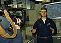 US Navy 060129-N-1464F-025 Lt. j.g. Aaron Riggio (right) explains the new Battle Management Center (BMC) and how it will provide true joint integration aboard the guided missile submarine USS Ohio (SSGN 726).jpg