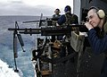 US Navy 060324-N-4166B-021 Sailors fire an M-60 and .50 caliber machine guns during a weapons' Familiarization Fire (Fam-Fire) on the Fantail of the Nimitz-class aircraft carrier USS Abraham Lincoln (CVN 72).jpg