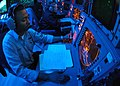 US Navy 060502-N-9079D-002 Operations Specialist 2nd Class Anthony S. Lampkin tracks contacts in Combat Direction Center (CDC) aboard USS Abraham Lincoln (CVN 72).jpg