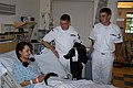 US Navy 060608-N-6247M-003 Hospital Corpsman 2nd Class Charles Mahan and Boatswain Mate 3rd Class Darrell Mercer talk with a patient during a visit to Dornbecher Shrinners Children's Hospital.jpg