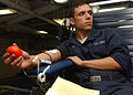 US Navy 061129-N-5416W-001 Engineman Fireman Andrew Hall participates in a ship's blood drive aboard the Nimitz-class aircraft carrier USS Theodore Roosevelt (CVN 71).jpg