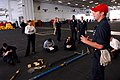 US Navy 061202-N-4133B-005 Damage Controlman 3rd Class Christopher Conrad from Goodhue, Minn., instructs Sailors on how to use shoring in the hangar bay aboard USS Ronald Reagan (CVN 76).jpg