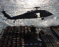 US Navy 061215-N-9708H-294 An MH-60S Seahawk helicopter assigned to Helicopter Sea Combat Squadron Two Six (HSC-26), station at Naval Station Norfolk, conducts a vertical replenishment.jpg