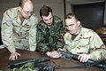 US Navy 070304-N-4034B-009 Culinary Specialist 2nd Class John Conniff and Electronics Technician 1st Class Ronnie Kearns receive instructions on assembling an M-16 rifle.jpg