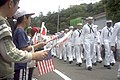 US Navy 070519-N-1251W-003 Crew members from the Arleigh-Burke class guided missile destroyer USS Curtis Wilbur (DDG 54) march past children waving flags during the 68th annual Shimoda Black Ship Festival.jpg