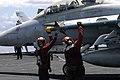 US Navy 070809-N-3349L-013 Sailors de-arm a CATM 9-M Sidewinder Missile on the flight deck of the nuclear-powered aircraft carrier USS Nimitz (CVN 68).jpg