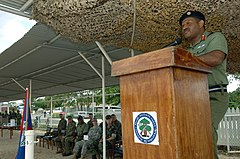 Brig. Gen. Lloyd Gillett, commander of the Belize Defense Force, addresses Belize soldiers and recruits during a ceremony marking the completion of small unit training with a U.S. Marine Corps mobile