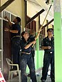 US Navy 071211-N-0000J-002 Lt. Tracie Weber, Lt. Jason Fox, both assigned to the guided-missile cruiser USS Port Royal (CV 73), face the equatorial heat to paint a schoolhouse in Timor-Leste.jpg