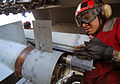 US Navy 080206-N-2984R-064 An aviation ordinanceman works on the launch mechanism of an AGM-65 Maverick air-to-surface missile aboard the Nimitz-class aircraft carrier USS Harry S. Truman (CVN 75).jpg