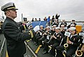 US Navy 081025-N-7441H-002 Lt. Carl Gerhard leads the Navy Band Northeast in a musical selection before the commissioning ceremony for the Virginia-class attack submarine USS New Hampshire (SSN 778).jpg