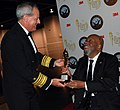 US Navy 090327-N-9268E-023 Vice Adm. Jeffrey L. Fowler presents a lifetime achievement award to retired Lt. Cmdr. Wesley Brown at the National Society of Black Engineers conference in Las Vegas.jpg