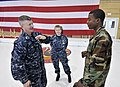 US Navy 090401-N-9712C-003 Master Chief Petty Officer of the Navy Rick West, left, speaks with Master-at-Arms 1st Class Carlos Jones at Naval Air Station Joint Reserve Base (NAS JRB) New Orleans.jpg