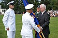 US Navy 090630-F-1256H-002 Navy Adm. James Stavridis, U.S. European Command commander, takes the USEUCOM guide-on from the Secretary of Defense Robert Gates, during a ceremony.jpg