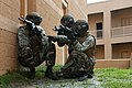 US Navy 090728-M-7752D-002 Midshipmen take cover during urban combat training at Marine Corps Base Camp LeJeune, N.C.jpg