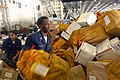 US Navy 090807-N-9132C-370 Information Systems Technician 3rd Class Calvin Lawson helps sort through 21,000 pounds of mail in the hangar bay of the aircraft carrier USS Ronald Reagan (CVN 76).jpg