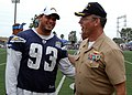 US Navy 090821-N-0483R-040 Capt. Ricky L. Williamson, commanding officer of Naval Base San Diego, speaks with San Diego Chargers defensive end Luis Castillo during a 45-minute, no-pads practice at Naval Base San Diego.jpg
