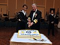 US Navy 091024-N-8273J-026 Chief of Naval Operations (CNO) Adm. Gary Roughead, right, and Airman Jessica Gill cut a cake to celebrate the Navy's 234th birthday.jpg