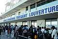 US Navy 100119-N-7037C-075 Haitian citizens wait for flights outside Toussaint Louverture International Airport.jpg