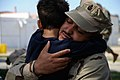 US Navy 100330-N-0475R-707 Senior Chief Construction Mechanic Renato Hidalgo hugs his son before departing for an eight-month deployment to Afghanistan.jpg