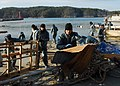 US Navy 110403-N-8607R-154 Sailors clean up debris from a harbor in Oshima, Japan.jpg