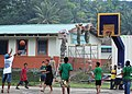 US Navy 110708-F-HS649-219 Micronesian boys play basketball next to the Ohmine engineering civic action project during the Federated States of Micr.jpg