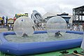 US Navy 110925-N-PC984-122 Children play in big inflatable water balls at the Kids Fest area during the Naval Air Station Oceana Air Show.jpg