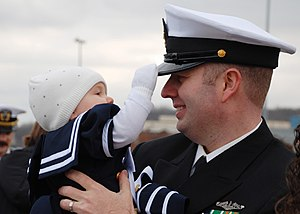 US Navy 111214-N-AW342-136 Chief Yeoman Matthew Gilliam is greeted by his daughter after returning from a scheduled 6-month deployment aboard the L.jpg