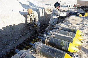 High-explosive squash head - 105 mm HESH rounds being prepared for disposal by the US Navy, 2011