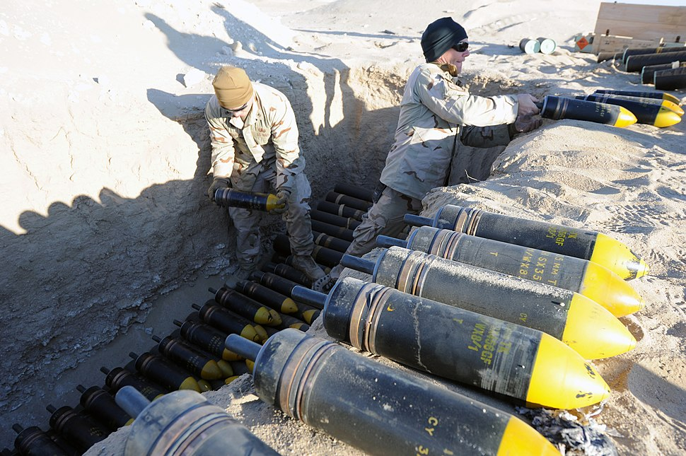 US Navy 111214-N-BA263-276 Explosive ordnance disposal technicians assigned to Commander, Task Group (CTG) 56.1 build a 1,500-pound munitions dispo