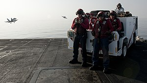 US Navy 120107-N-OY799-188 Sailors stand crash and salvage watch on the bow as two fixed wing aircraft launch off the flight deck of the Nimitz-cla.jpg