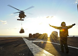US Navy 120120-N-VH054-113 An HH-60H Sea Hawk helicopter picks up supplies from the Military Sealift Command fleet replenishment oiler USNS John Le.jpg
