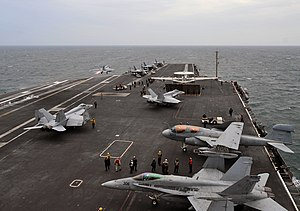 US Navy 120131-N-YB753-037 Aircraft assigned to Carrier Air Wing (CVW) 2 launch from the Nimitz-class aircraft carrier USS Abraham Lincoln (CVN 72).jpg
