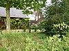 foto van Boerderij van type kop-hals-romp met aangebouwde dwarsstal en mestvaalt