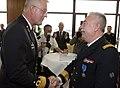 Viceadmiraal-borsboom-feliciteert-divisieadmiraal-robyns-met-de-medaille.jpg