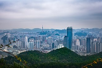 Guiyang - View of the modern Guiyang skyline from the neighboring natural mountain areas, which are protected as national parks