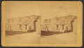 View of an individual standing next to wooden beams that are leaning against an adobe structure, by Wittick, Ben, 1845-1903.png